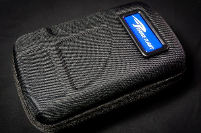 Black hard shell case on black background